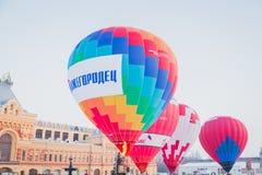 Mass-start on the festival of hot air ballons. NIZHNY NOVGOROD, RUSSIA - FEBRUARY 24, 2018. Mass-start on the festival of hot air ballons Stock Image