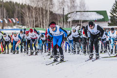 Mass start of skiers athletes marathon distance Royalty Free Stock Photos
