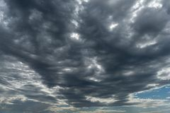 Storm clouds in perspective with horizon. A mass of rain bearing storm clouds in a wide angle perspective with distant horizon stock images