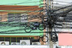 Mass communication wires on electric pole in Bangkok Thailand. royalty free stock photos