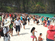 Mass tourism on the beach stock photography