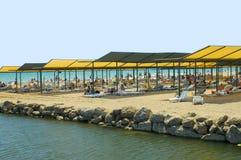 Mass tourism beach Turkey. Mass tourism people near the beach in Turkey Stock Image