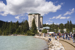 Mass tourism on lake louise near the chateau Stock Image