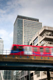 Mass transit train in city. A speeding urban commuter train on an elevated train track in a modern city Stock Images