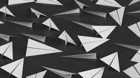 Mass of White Paper Planes on a Modern Reflective Black Surface Royalty Free Stock Photography