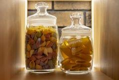 Massa colorida em uma prateleira em um frasco de vidro em um interior moderno fotografia de stock royalty free