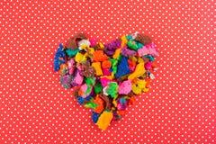 Massa colorida seca do jogo na forma do coração Imagem de Stock Royalty Free