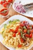 Massa com cogumelos, tomates de cereja e molho de tomate, alimento italiano closeup fotografia de stock royalty free