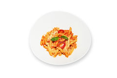 Massa com o tomate no prato branco isolado Imagem de Stock