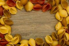 Massa de Shell no quadro de madeira da opinião de tampo da mesa Foto de Stock Royalty Free
