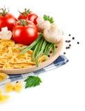 Massa italiana com tomate e cogumelos foto de stock
