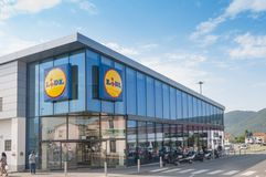 A lidl grocery store in Italy. MASSA, ITALY - JULY 26, 2018 - The main entrance to a Lidl grocery store in Italy royalty free stock image