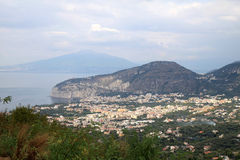 Massa Lubrense and Vesuvius, Italy. Massa Lubrense is at the tip of the Sorrento Peninsula in the South of Italy. It was known to the Romans, who held sporting Stock Images