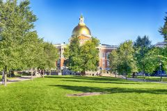 Massachusetts State House and Boston Commons. The Massachusetts state house located on the Boston Commons in Boston Massachusetts in the morning sunlight royalty free stock image