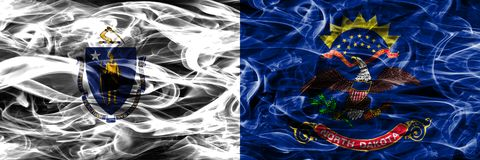 Massachusetts vs North Dakota colorful concept smoke flags placed side by side.  royalty free stock images