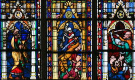 The Massacre of the Innocents. The biblical recount of infanticide by Herod the Great, on a stained glass in the cathedral of Rouen Royalty Free Stock Photography