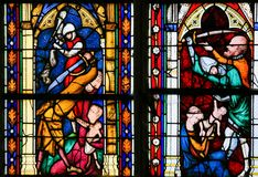 The Massacre of the Innocents. The biblical recount of infanticide by Herod the Great, on a stained glass in the cathedral of Rouen Stock Photography