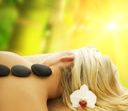 Massage. With hot volcanic stones Stock Photography