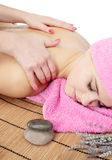Massage. Beautiful young woman delights in by the massage Stock Photo