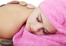 Massage. Beautiful young woman delights in by the massage Royalty Free Stock Image
