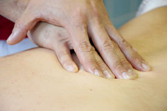 Massage. Medical massage with two hands Royalty Free Stock Image