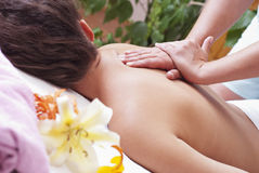 Massage. Close-up of a young woman receiving back massage at spa Royalty Free Stock Photos