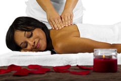 Massage. Young African American woman getting a massage Royalty Free Stock Photography