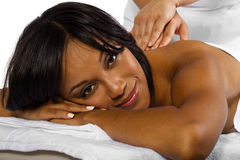 Massage. Young African American woman getting a massage Royalty Free Stock Images