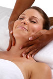 Massage. Woman getting a getting relaxing massage in salon Royalty Free Stock Photo