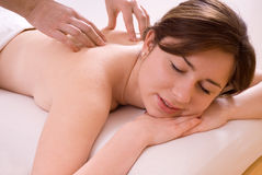 Massage. Girl getting massage, lying down stock photography