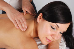 Massage. Attractive brunette woman relaxing in massage Royalty Free Stock Photos
