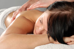 Massage. Attractive brunette woman relaxing in massage Royalty Free Stock Photo