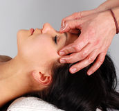 Massage. Attractive brunette woman relaxing in massage Stock Image