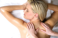 Massage. A woman gets a massage at a day spa Stock Image