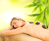 Massage. With volcanic hot stones Royalty Free Stock Photo
