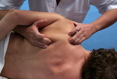 Massage. Shoulder massage Stock Image