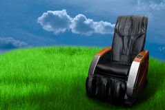 Massage arm-chair. On the green grass field stock images