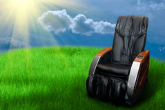 Massage arm-chair on the grass field stock image