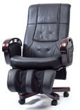 Massage Armchair. An elegant black leather massage armchair with clipping path Royalty Free Stock Photo