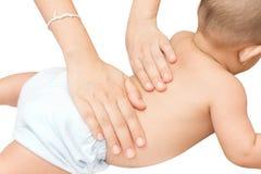 Massage arrière de bébé Photos libres de droits