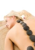 Massage avec des pierres Photographie stock libre de droits