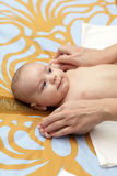 Massage of baby hands. At home in the morning Stock Photo