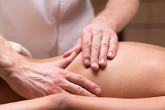 Massage for back pain relief Stock Images