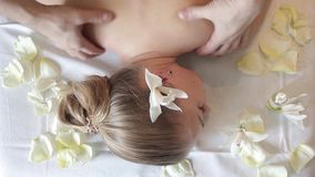 Massage the back. Woman having massage in the spa salon. Body care. stock video footage