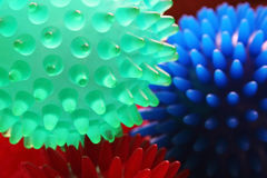 Massage Balls. Three small rubber massage balls in red, green and blue stock photo
