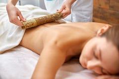 Massage with bamboo sticks Royalty Free Stock Photo