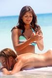 Massage at the beach Royalty Free Stock Photo