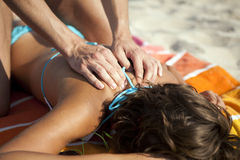 Massage on the beach. Woman getting massage on the beach royalty free stock photos