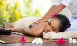 Massage. Beautiful Balinese woman getting a massage royalty free stock images