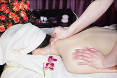 Massage in beauty salon Stock Photos